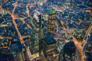 A general view of the recently constructed Leadenhall Building and Tower 42 at night in London, England.