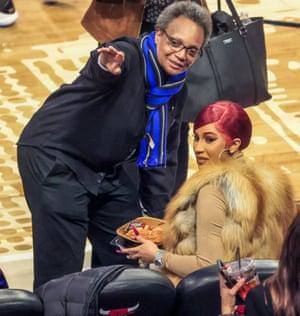 Hoops at the hoops, Chicago mayor Lori Lightfoot and rap star Cardi B at a basketball game.