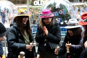 Revellers play Kendama while they are waiting.