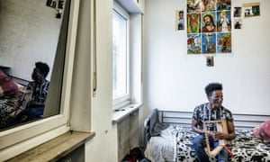 Amanuel Yemane, 18, from Eritrea, playing the krar in his room in home for unaccompanied minors in Bielefeld.