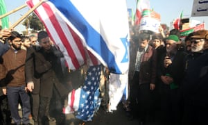 Iranians burn US and Israel flags in a state-organised rally in Mashhad, January 2018