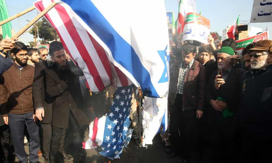 Protesters burn US and Israel flags during a pro-government rally, Mashhad, Iran, January 2018