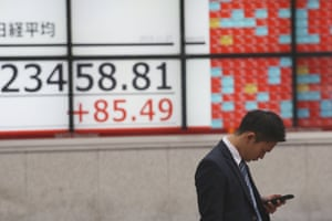 An electronic stock board of a securities firm in Tokyo, Wednesday.