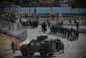 United States Military personnel and Border Patrol agents secure the United States-Mexico border at the San Ysidro border crossing point