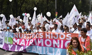 Members of the National Front for the Family march in Mexico City to protest President Enrique Peña Nieto's initiative to legalise gay marriage on September 24, 2016.