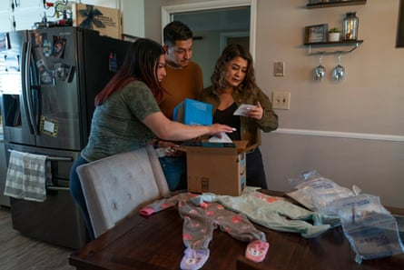 Miguel, Alexis, and Alexis's mom, open baby gifts at their families house in Clovis, California.