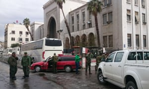 Syrian security forces cordon off the area near the Palace of Justice following the reported suicide bombing.