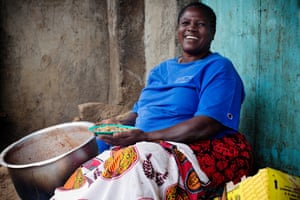 "Mary Nasia cooks and sells beans to make a living on the side of the road in Kibera. ""People like my beans and I am happy to sit here and watch the world go by,"" she says"