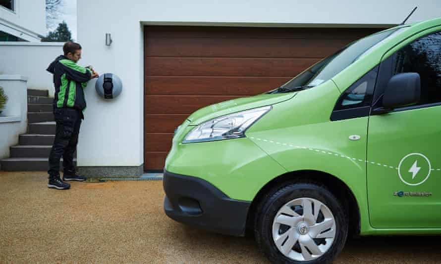 A Pod Point engineer at a charging  point