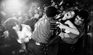 A yung woman faints during a Menudo concert at Madison Square Garden, New York City.