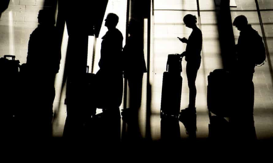 Passengers queue at Hamburg airport in Germany