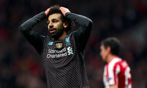Mohamed Salah reacts after a missed chance.