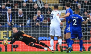 Leicester City keeper Kasper Schmeichel gets down well to save from Crystal Palace's Ruben Loftus-Cheek.