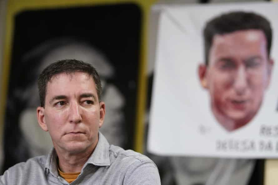 Glenn Greenwald listens to a question before a protest in his support in front of the headquarters of the Brazilian Press Association in Rio de Janeiro in July.