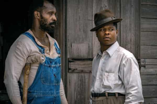Rob Morgan and Jason Mitchell as Hap Jackson and Ronsel Jackson in Mudbound.