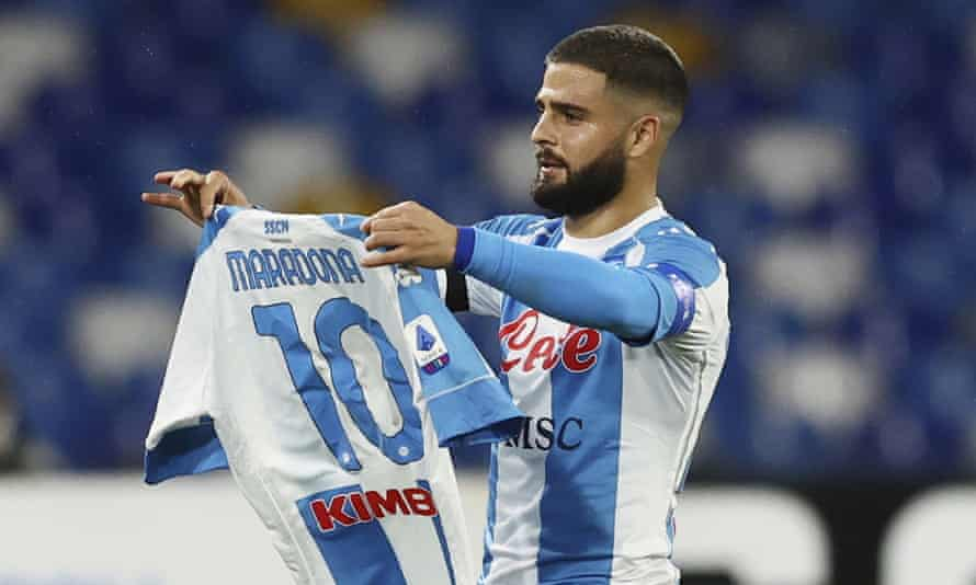Lorenzo Insigne holds up a Napoli shirt with Maradona's name and number after scoring against Roma.
