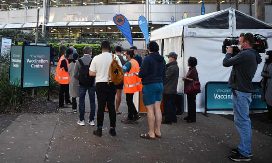 A queue forms outside a mass Covid vaccination hub in Sydney, Australia
