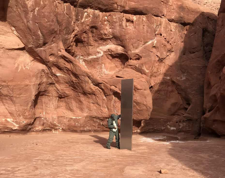 A Utah state worker next to the red rock country monolith.