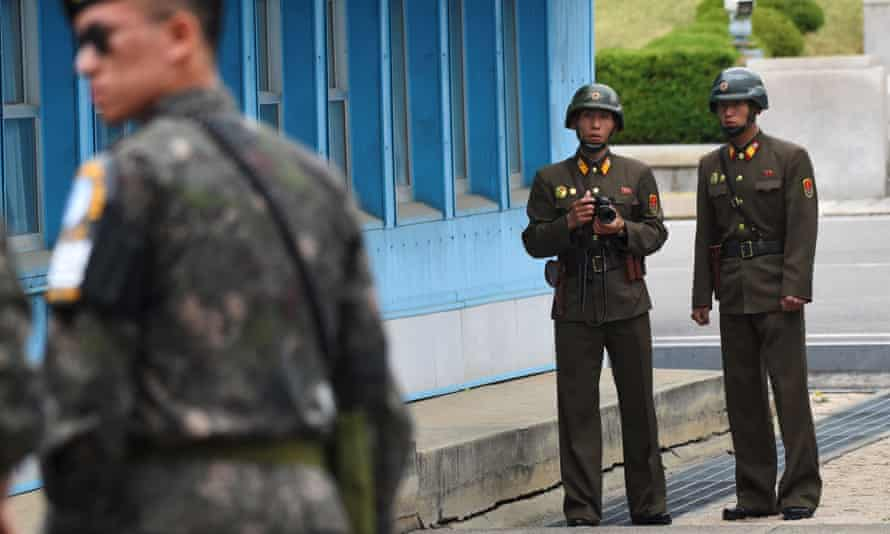 North Korean soldiers look at the South side during Mike Pence's visit.