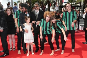 Esther Corvez-Beaudoin with actors dressed as zombies arrive with the cast of 'Zombillenium' arrive on the red carpet