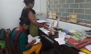 Workers at the Usha bank in Kolkata