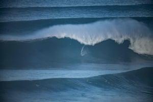 Brazilian Carlos Burle catches a wave.