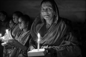 Nafeesa Bee takes part in a candle light vigil in Bhopal marking the 34th anniversary of the explosion.