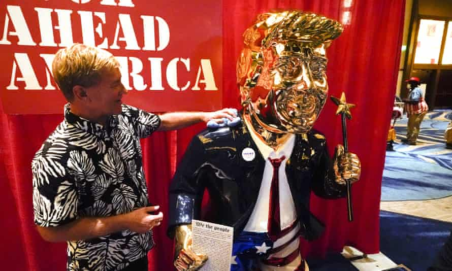 Sculptor Tommy Zegan polishes his statue of Donald Trump at CPAC.
