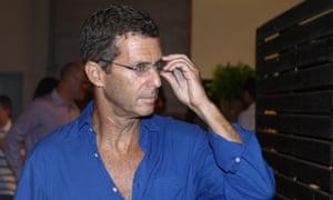 Beny Steinmetz wearing open-necked blue shirt