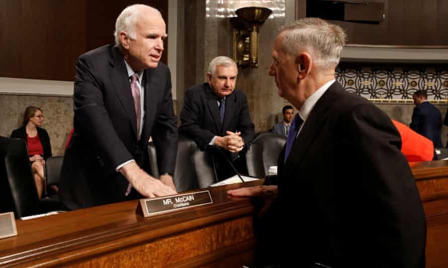 James Mattis greets John McCain prior to testifying.