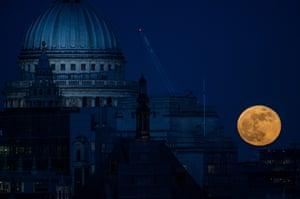 A supermoon rises behind St. Paul's Cathedral in London