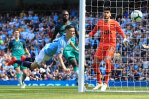 Phil Foden scores to win the match 1-0 for Manchester City, ensuring the reigning champions maintained the pressure on rivals Liverpool.