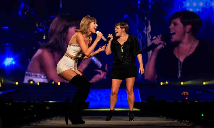 Natalie Maines joins Taylor Swift on stage in Los Angeles in 2015.