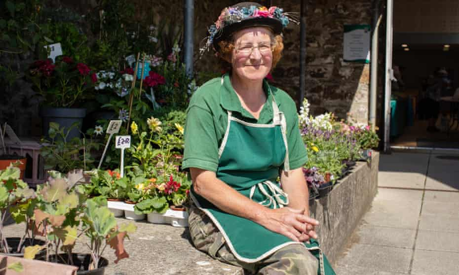 Helen Lessiter at her flower and plant stall on Fishguard Market, Wales.