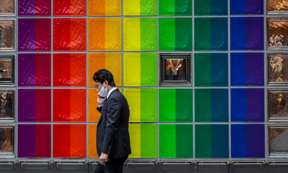 A man wearing a mask walks through the Ginza area in Tokyo, Japan