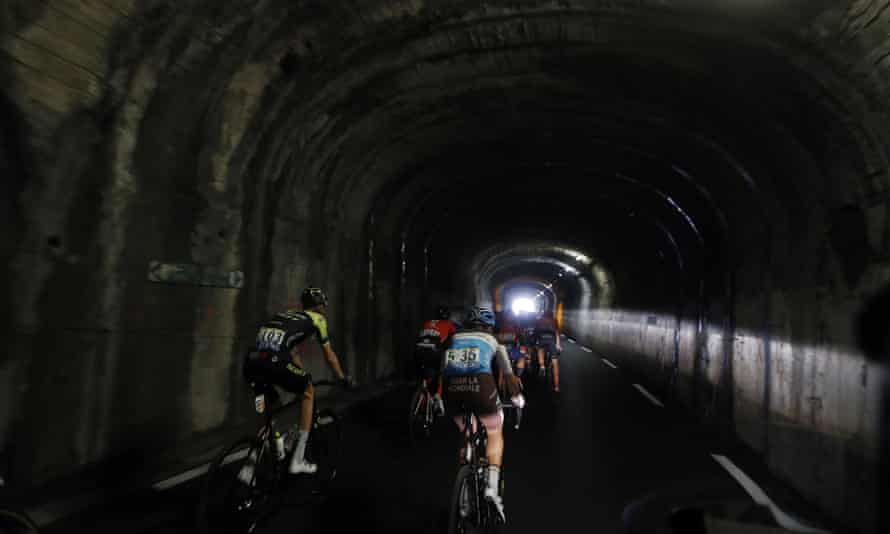 Jack Haig, left, and Tony Gallopin, ride with the pack in a tunnel during the eighteenth stage between Embrun and Valloire.