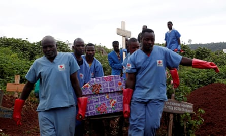Red Cross workers carry the coffin of an Ebola victim to be buried in the eastern town of Butembo in the Democratic Republic of the Congo