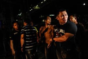 Police seize a drug suspect in a raid in Manila