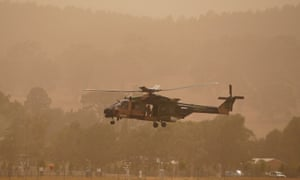 An Army helicopter lands at Canberra Airport amidst bushfire smoke on January 23, 2020 in Canberra, Australia.