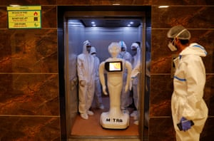 Mitra shares a lift in a hospital in Noida. The robot is being used to treat Covid patients.