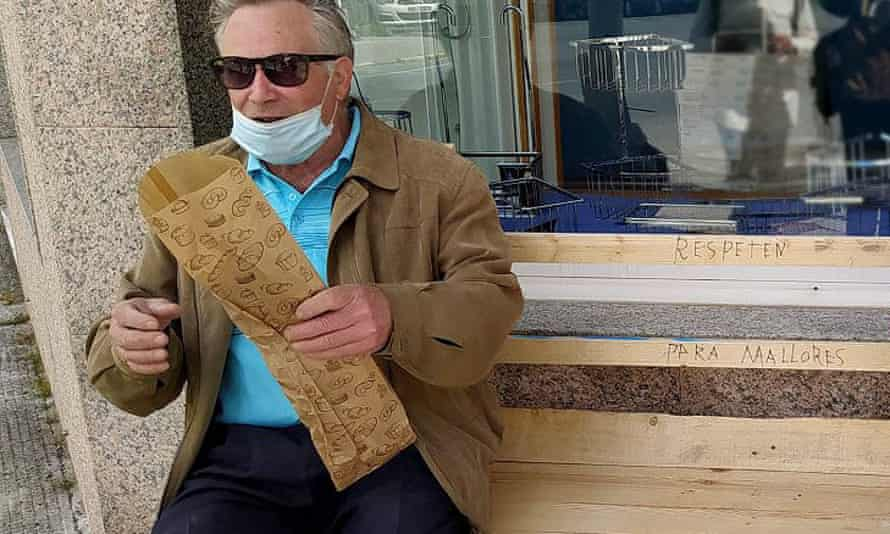 Manuel Souto, 82, sitting on the bench he knocked up for his wife, María Souto, who is 79 and has osteoarthritis.