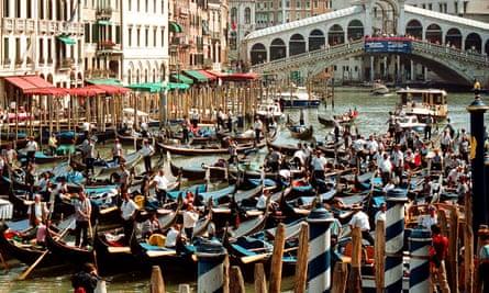 Hundreds of gondolas on Venice's main Canal Grande waterway, close to the Rialto Bridge.