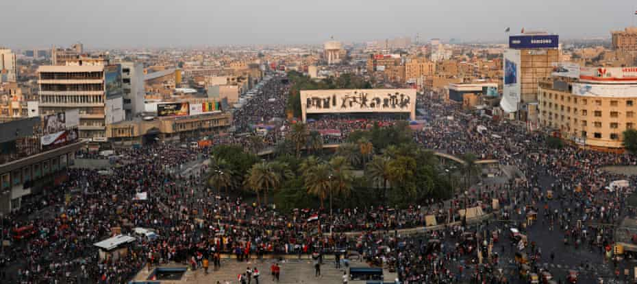Thousands protest over corruption, lack of jobs and poor services in Tahrir Square, Baghdad, on Monday.