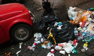 Refuse is strewn next to an old Fiat 500 in central Rome