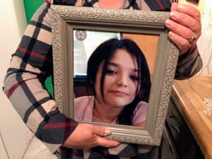 Cristina Benavides holds a photograph of her daughter, Melissa Ramirez, at her home in Rio Bravo, Texas.