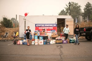 A donation drop-off and pick-up station set up by volunteers is seen at an evacuation site in the parking lot of the Clackamas Town Center in Happy Valley, Oregon, on September 11, 2020. -