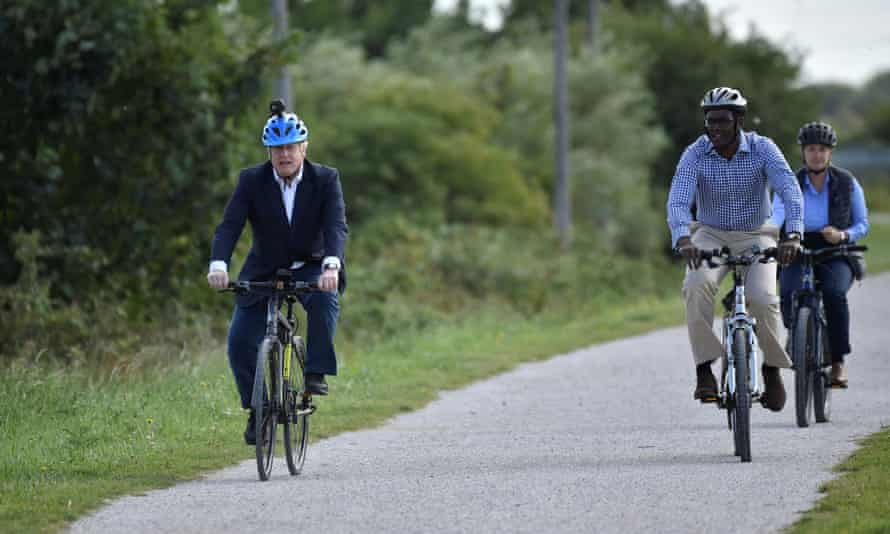 Boris Johnson is a keen cyclist, pictured here riding his bike in Beeston with Conservative MP for Broxtowe Darren Henry after the government announced a new plan to get Britain cycling during the coronavirus pandemic, 28 July 2020.