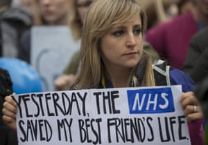Protester holds a placard at a demonstration in support of junior doctors in London