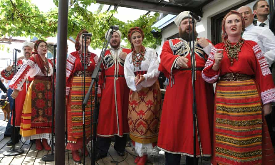 A Cossack choir serenades Austrian foreign minister Karin Kneissl and her groom Wolfgang Meilinger at their wedding.