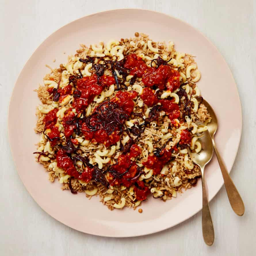 Koshari: rice, lentils and pasta, topped with a sharp tomato sauce and fried onions.